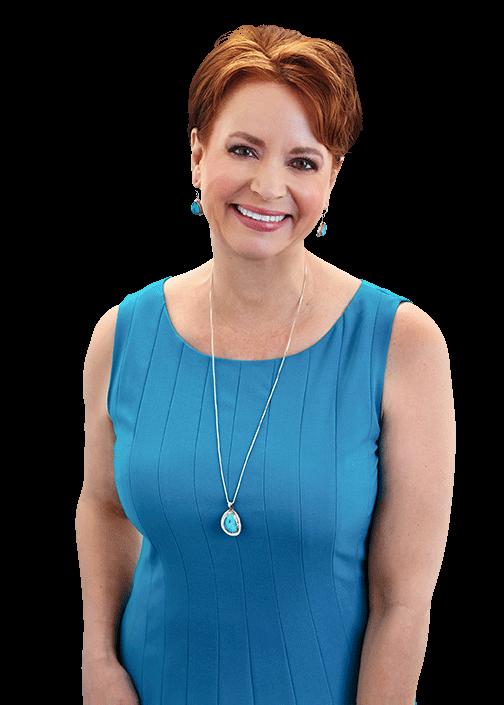 Deborah Elliott-Shultz smiling in a blue dress