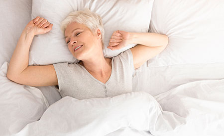 woman waking up refreshed from a great nights sleep